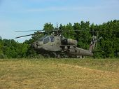 picture of apache  - Apache Helicopter parked on a grass airfield - JPG