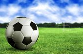 stock photo of football pitch  - football by a football pitch - JPG