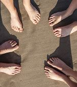picture of wet feet  - feet at the wet beach in harmonic pattern - JPG
