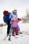 picture of family ski vacation  - Photo of Caucasian family fond of skiing on mountainside in winter - JPG
