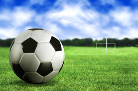 image of football pitch  - football by a football pitch - JPG