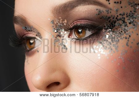 Eye Makeup. Closeup of Beautiful Woman Eye with Glitter Makeup. Fancy Makeup, False Eyelashes