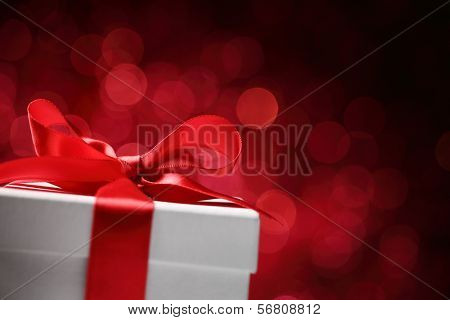 Holidays gift box on red background