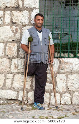 SARAJEVO, BOSNIA AND HERZEGOVINA - AUG 13: Redzep Osmani, land mine victim on August 13, 2012 in Sarajevo, B&H. Father of 10 children lost his hand and leg on land mine.