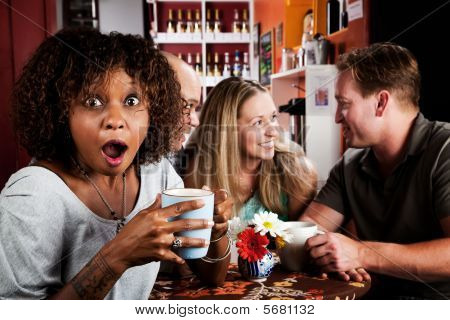 Shocked African American Woman With Friends