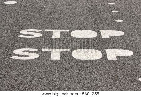 Stop Sign On Paved Road