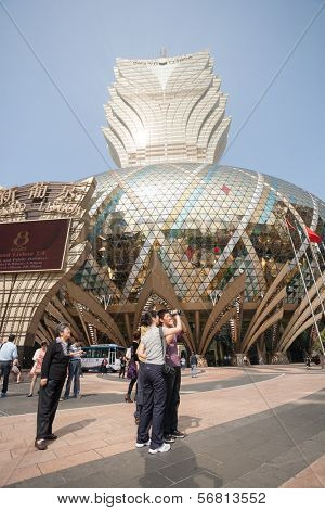 MACAU, CHINA - NOVEMBER 2, 2012: Tourists at the Grand Lisboa Casino - one of the largest and popular casino. Macau is the gambling capital of Asia and is visited by about 29 million tourists annually