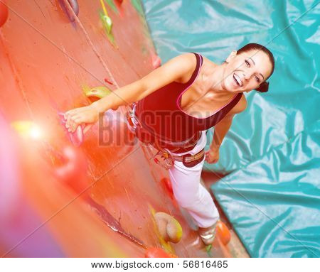 women climbing on a wall in an outdoor climbing center