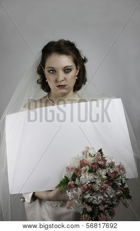 Bridezilla holding blank sign