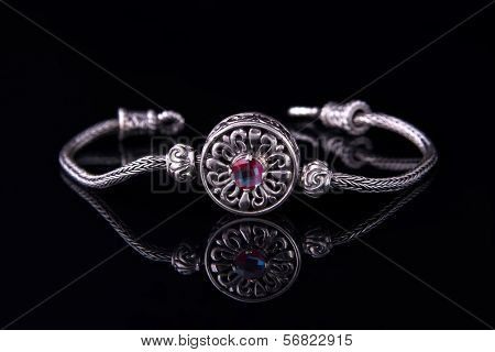 Beautiful silver bracelet on black background