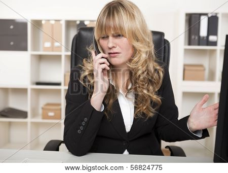 Businesswoman Having An Argument Over The Phone