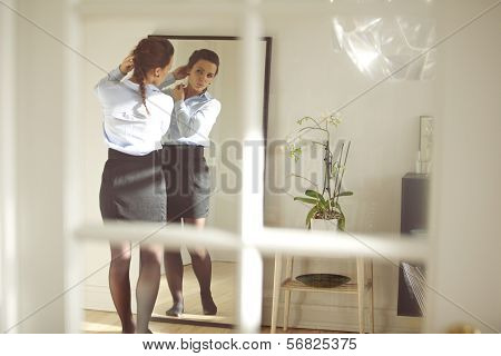 Young Businesswoman In Front Of Mirror