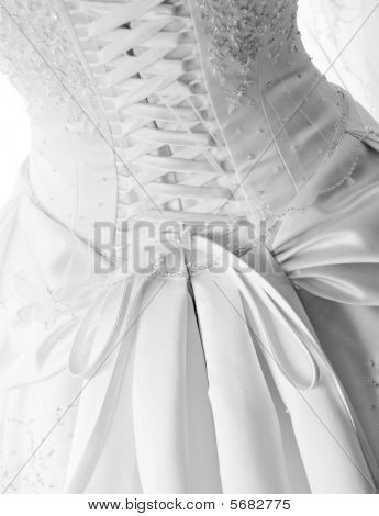 Black And White Image Of Laces On Back Of Wedding Gown