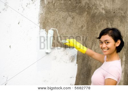 Happy Woman Painting Exterior Wall