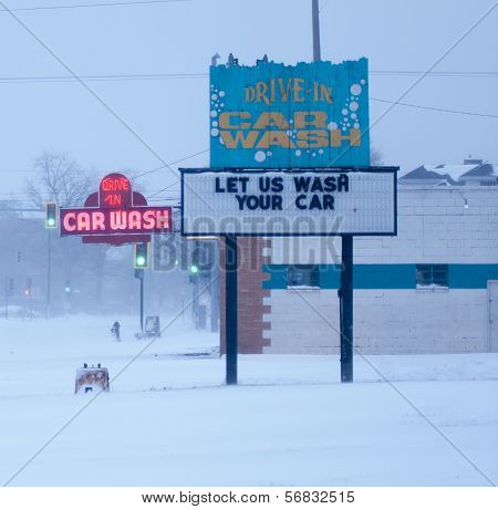 Neon Car Wash Sign In Snow Storm.