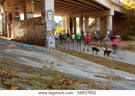 Motion Blurred Composite Of People Exercising In Urban Setting