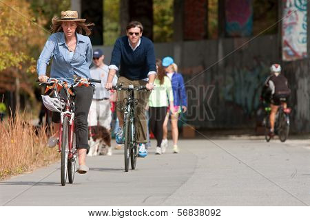 Couple Rides Bikes Along Urban Development Trail In Atlanta