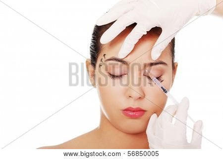 Cosmetic botox injection in the female face, eye and eyebrow zone