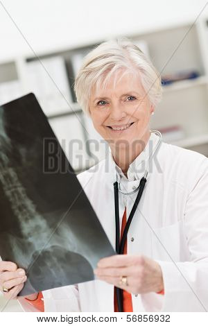 Smiling Physician Checking A Pelvic X-ray