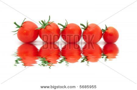 Beautiful Ripe Tomatoes With Reflexion In Water