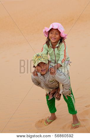VIETNAM, DEC 9: Vietnamese local children at the Red Sand Dunes