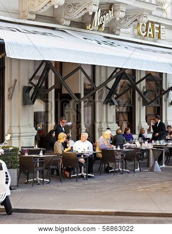 Some People Enjoy A Cup Of Coffee at a Traditional Viennese Cafe