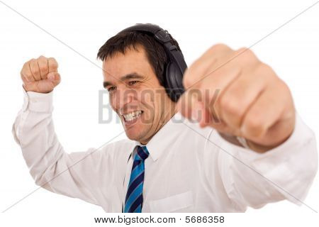 Businessman Releasing Stress Listening To Music
