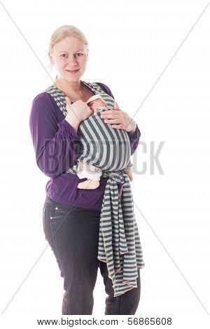 Newborn baby in sling
