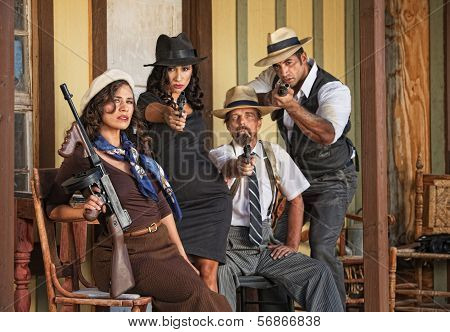 1920S Era Gangsters Aiming Guns