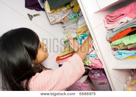 Little Girl And Clothing