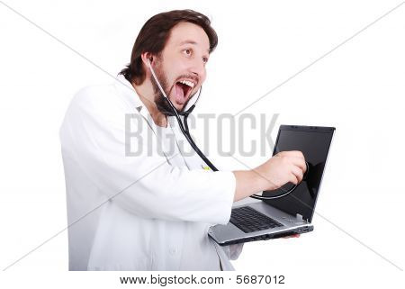 Young Male Doctor Is Taking Care Of Laptop