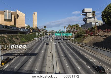 LOS ANGELES, CALIFORNIA - November 24, 2013:  Traffic free weekend view of the Hollywood 101 Freeway, Catholic Cathedral and School of Visual and Performing Arts in downtown Los Angeles.