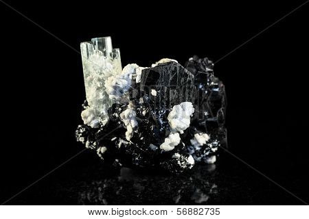 Schorl And Aquamarine Crystal In Front Of Black