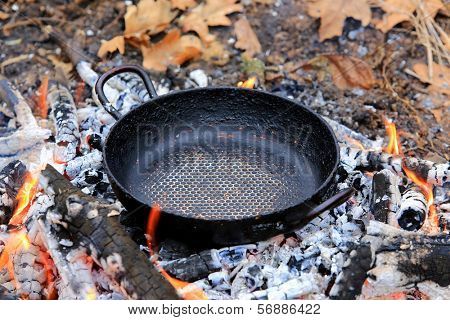 tourist frying pan on hot embers