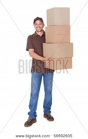 Happy Man Holding Stack Of Cardboxes