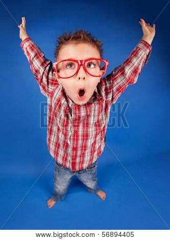 Active funny five years old boy with expressive face, jumping, playing concept