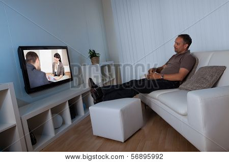 Man Watching Home Movies