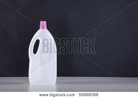 Cleaning products next to a black chalkboard