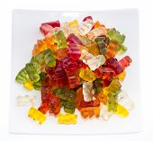 stock photo of gummy bear  - Heap of Gummi Bears on a plate isolated on white background - JPG