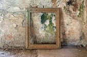 stock photo of abandoned house  - Room in the ruins of a house with a frame for the picture - JPG