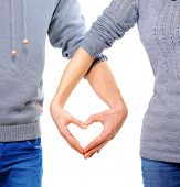 stock photo of casual wear  - Valentine Couple in love showing Heart with their fingers - JPG