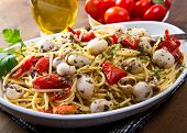 stock photo of spaghetti  - dish with spaghetti with cuttlefish and tomatoes - JPG