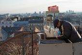 ZAGREB, CROATIA - JANUARY 12, 2014: Stret vendor in Zagreb, Croatia. Selling popcorn and roasted che