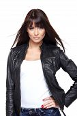 stock photo of straight jacket  - Glamorous young woman in black leather jacket on white background - JPG