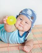 Cute beautiful baby is playing toy