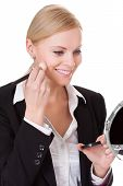 Attractive Businesswoman Applying Foundation