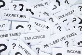 foto of income tax  - Tax concept with text of tax and question mark - JPG