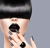 High Fashion Model Girl Portrait with Trendy Hair style, Black Make up and Manicure. Long Black Glos
