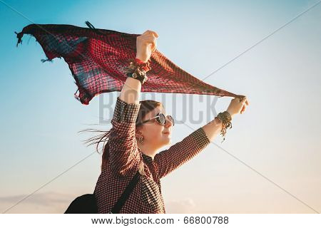 Romantic Young Woman With Red Fluttering Scarf