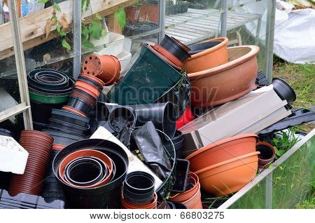 Large pile of empty plant pots